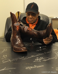 Willie checks out a pair of custom made World Series boots before the game on August 4, 2011
