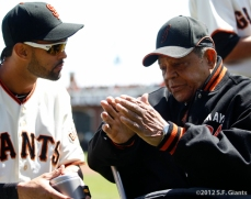 Willie goes over the finer points of playing center field with Angel Pagan during the pregame festivities on Opening Day.