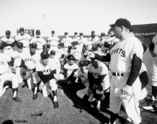 Herman Franks talks with his players