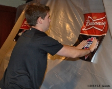The Budweiser NL West Champs posters are put on the plastic