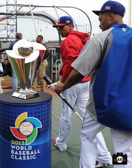 Dominican players check out the WBC Trophy