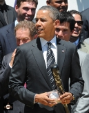 President Obama with the gifts presented to him
