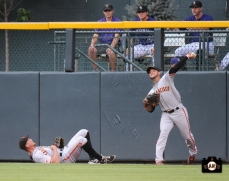 gregor blanco, hunter pence, ,runs into wall, colorado, coors field, colorado rockies, photo, sf giants right field