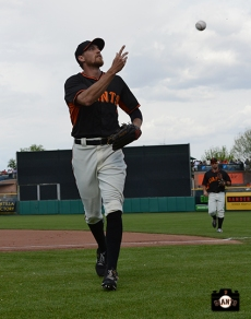 Hunter Pence plays right field at Scottsdale Stadium on Friday, March 14, 2014.