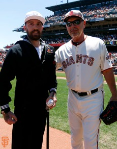 Petty Officer Jordan Stevenson and Bruce Bochy
