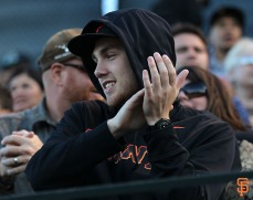 Fans watch the Giants' game on Wednesday, July 9, 2014.