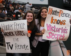 Fans watch the Giants' game on Tuesday, August 12, 2014.