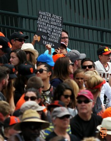 Fans watch the Giants game on Wednesday, August 13, 2014.