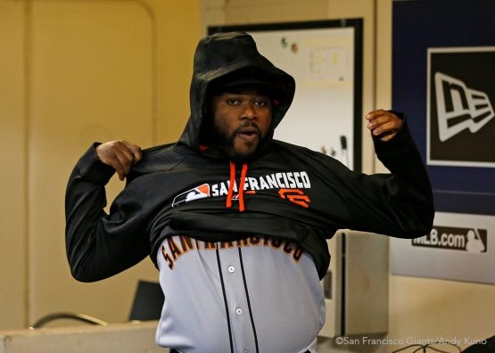 San Francisco Giants pitcher Johnny Cueto puts on a sweatshirt before the game. The Giants defeated the Brewers 2-1.