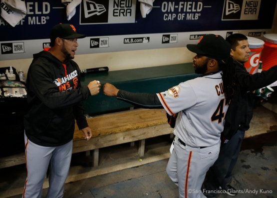 San Francisco Giants pitcher Johnny Cueto fist bumps Gregor Blanco. The Giants defeated the Brewers 2-1.