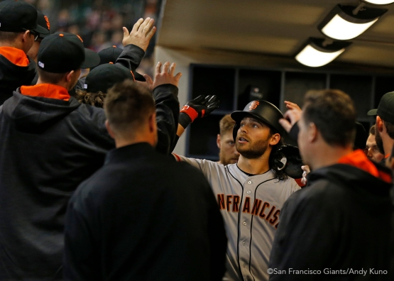 San Francisco Giants Brandon Crawford celebrates his 3rd inning homer with teammates. The Giants defeated the Brewers 2-1.