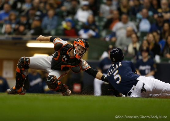 San Francisco Giants catcher Buster Posey tags out Brewers Jonathan Villar in the 3rd inning. The Giants defeated the Brewers 2-1.