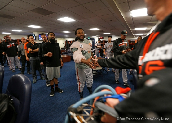 San Francisco Giants pitcher Johnny Cueto celebrates his first win as a Giant with teammates.