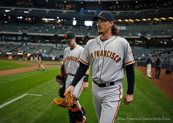 San Francisco Giants pitcher Jeff Samardzija and catcher Buster Posey walk to the bullpen.