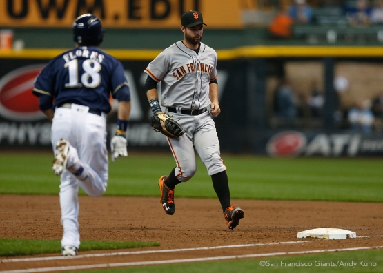 San Francisco Giants first baseman Brandon Belt forces out Brewers Ramon Flores in the 3rd inning.