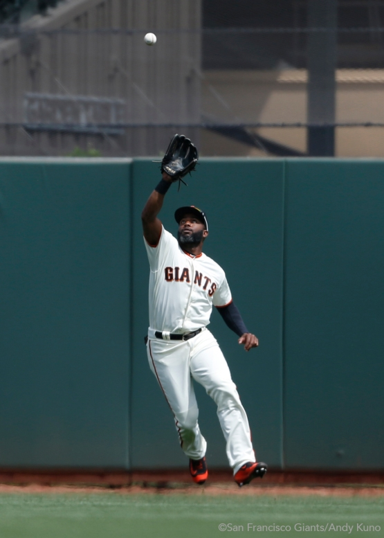 Denard Span catches a fly ball in center field during the third inning.