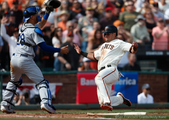 Joe Panik scores on a single hit by Buster Posey.