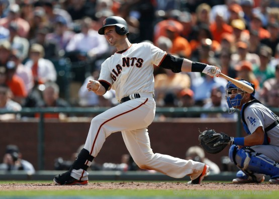 Buster Posey hits an infield single during the fourth inning.