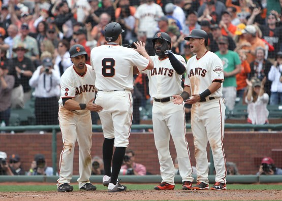 Angel Pagan, Hunter Pence, Denard Span and Joe Panik celebrate after all scoring on Hunter Pence's grand slam.