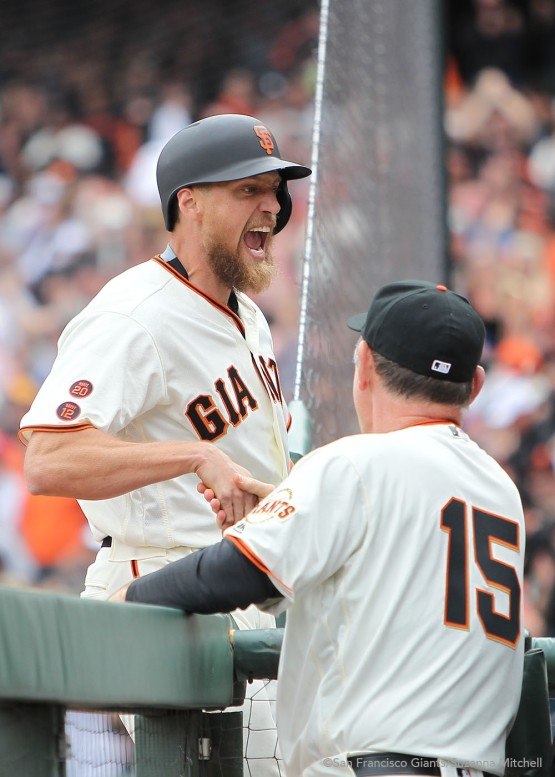 Hunter Pence celebrates as he enters the dugout after hitting a grand slam.