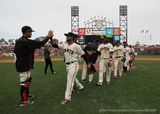 The Giants high five after notching their first win at AT&T Park.