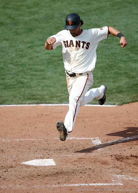 Angel Pagan scores on a single hit by Joe Panik during a sixth inning rally.