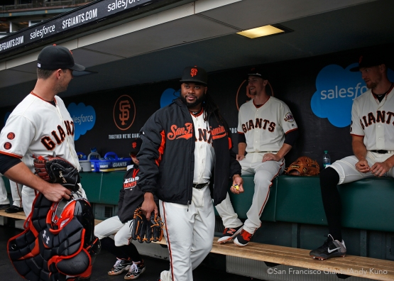 San Francisco Giants pitcher Johnny Cueto shares a laugh with teammates before the game. The Giants defeated the Dodgers 9-6.