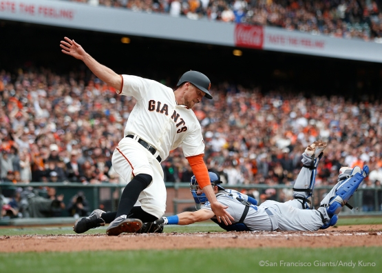 San Francisco Giants Hunter Pence scores a 1st inning run. The Giants defeated the Dodgers 9-6.