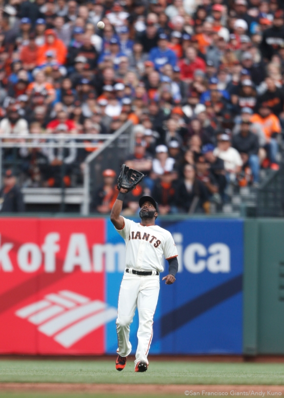 San Francisco Giants center fielder Denard Span catches a ball during the 2nd inning. The Giants defeated the Dodgers 9-6.