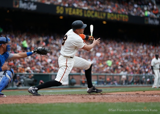 San Francisco Giants Hunter Pence hits a sacrifice fly during the 5th inning. The Giants defeated the Dodgers 9-6.