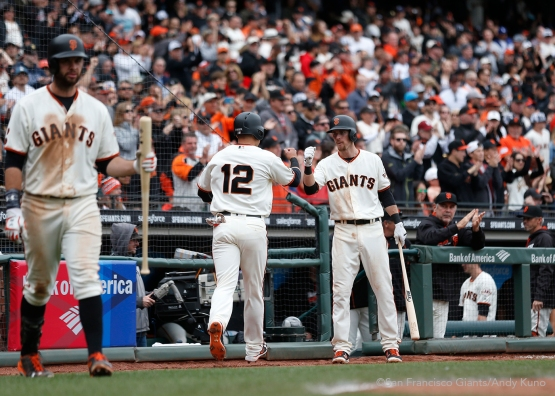 San Francisco Giants Joe Panik fist bumps Matt Duffy after scoring a run during the 5th inning. The Giants defeated the Dodgers 9-6.