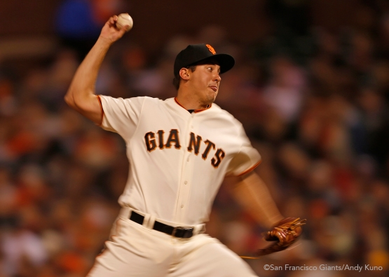 San Francisco Giants pitcher Derek Law pitches in the 9th inning.