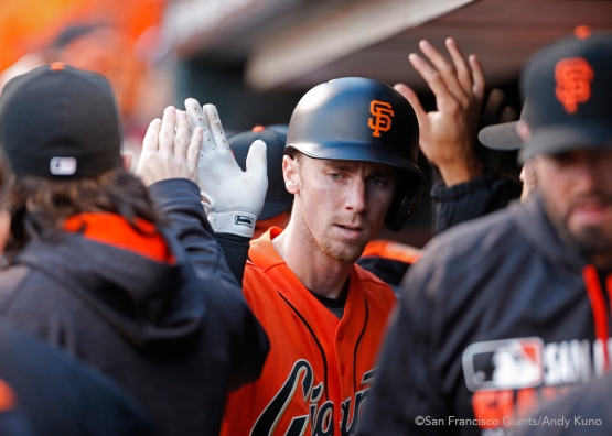 San Francisco Giants Matt Duffy celebrates his sacrifice fly with teammates.