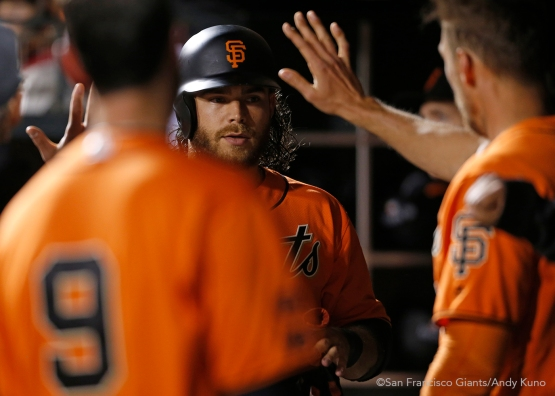 San Francisco Giants Brandon Crawford high fives teammates during the 5th inning.