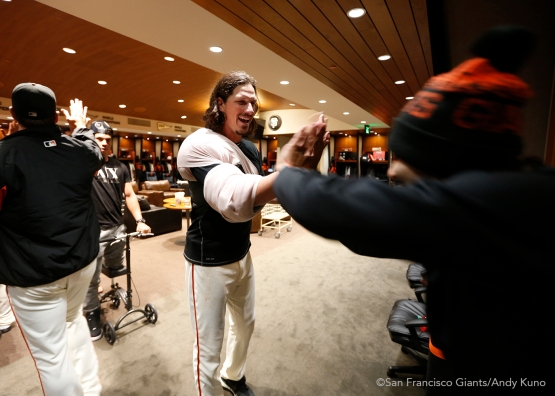 San Francisco Giants pitcher Jeff Samardzija high fives Sergio Romo after beating the Marlins 8-1.