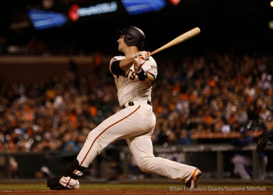 Buster Posey hits a home run in the seventh inning.