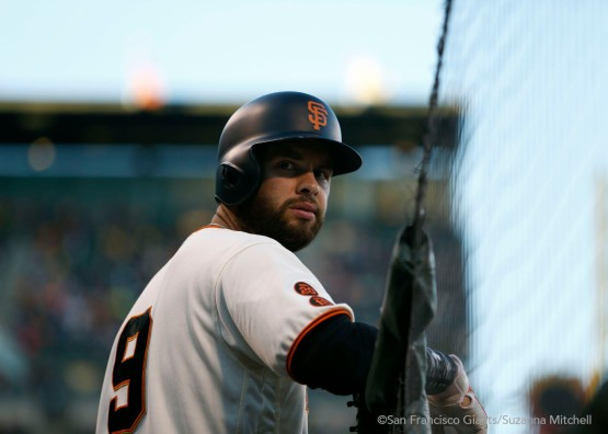 Brandon Belt waits in the hole.