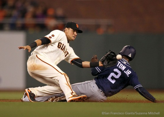 Joe Panik attempts to tag out Melvin Upton Jr. stealing second base.