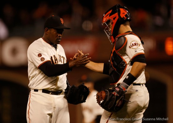 Santiago Casilla and Buster Posey shake hands after the final out.