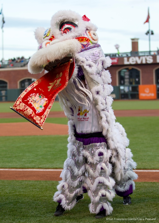 A dragon performs a traditional Chinese dance before the game.