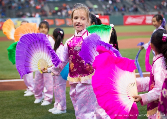 Fan dancers perform on the field before the game against the San Diego Padres.