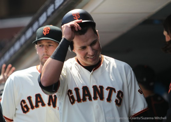 Joe Panik celebrates after scoring on a triple hit by Brandon Belt.
