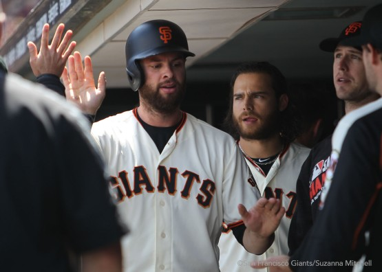 Brandon Belt celebrates after scoring on a single hit by Hunter Pence in the fourth inning.