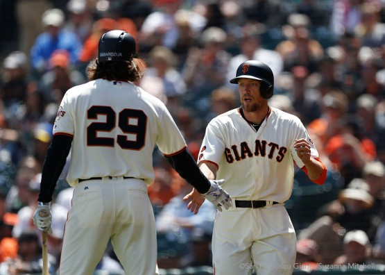 Hunter Pence high fives Jeff Samardzija after scoring on a single hit by Trevor Brown in the fourth inning.