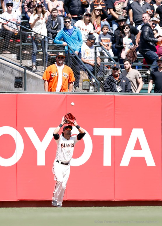 Angel Pagan catches a fly ball in left field hit by Matt Kemp in the sixth inning.