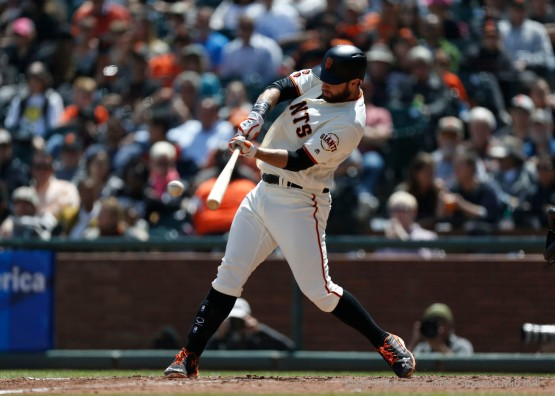 Brandon Belt triples in the fourth inning.