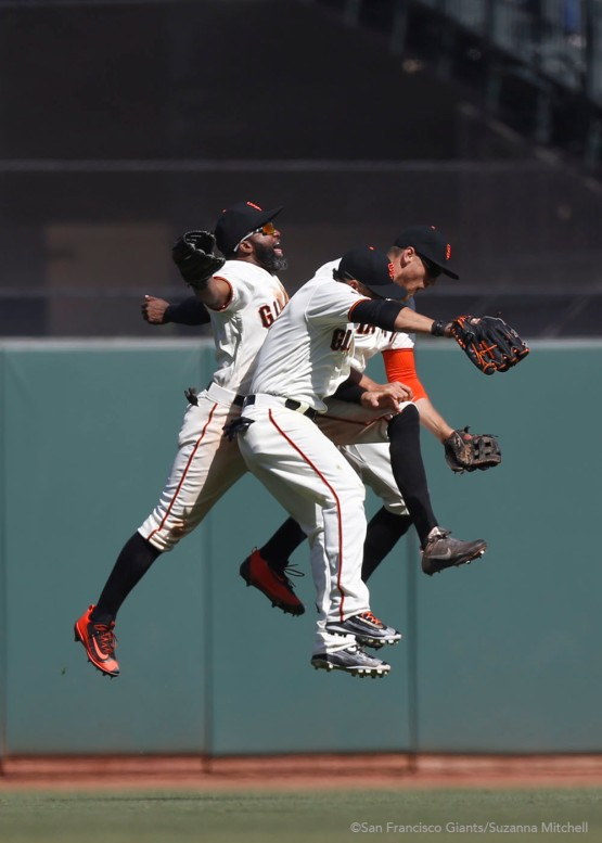 Denard Span, Gregor Blanco and Hunter Pence celebrate after the final out.