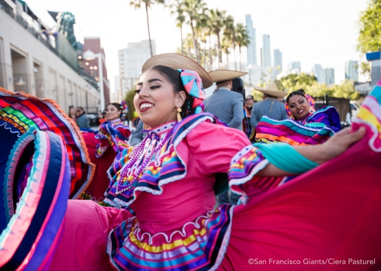 Dancers celebrate Cinco de Mayo at Seals Plaza before the game.