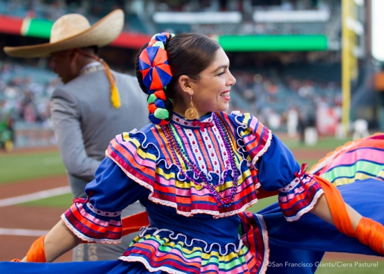 Dancers from Grupo Folklorico Los Laureles perform on the field before the game.