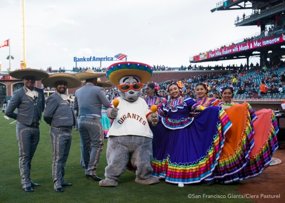 Grupo Folklorico Los Laureles poses with Lou Seal.